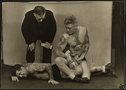 C.J. Bulliet observing two tattooed wrestlers