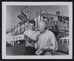 Photograph Louis Bunce with a model of a mural