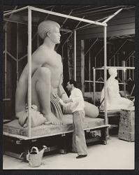 Brents Carlton doing finishing work on his sculpture Polynesian boy