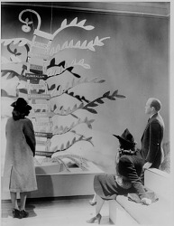 Viewers examining display for exhibition Modern Painting Isms and How They Grew, Baltimore Museum of Art, 1940