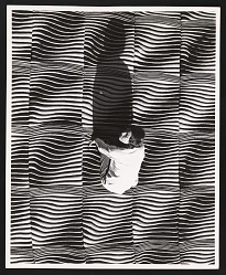 Photograph of Lia Cook kneeling on Space Continuum I