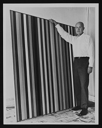 Portrait of Gene Davis with his artwork