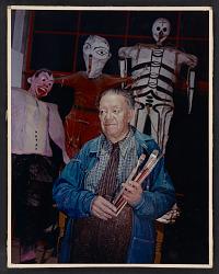 Portrait of Diego Rivera holding paintbrushes