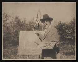 Photograph of Edward Gay painting outdoors