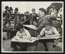 Photograph of Chiura Obata teaching a children's art class at Tanforan Art School