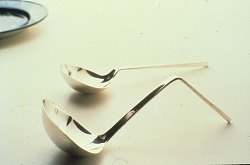 """Two sterling silver ladles in the """"taper"""" pattern, designed by Arthur Pulos"""
