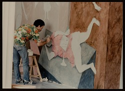 Arturo Rodríguez painting his mural, The Great Theater of the World