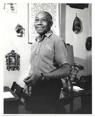 Ellis Wilson standing in front of a desk