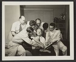 clockwise from left: Jack Delano, John Vachon, Edwin Rossham, John Collier, Edwin Lock, Russell Lee, and Roy E. Stryker