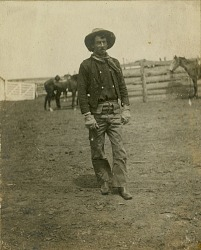 Cowboy standing in corral
