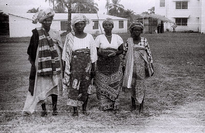 Field Work in Ibadan, Western Region (Nigeria): Four Women (probably Yoruba Informants) Wearing Elaborate Headdresses