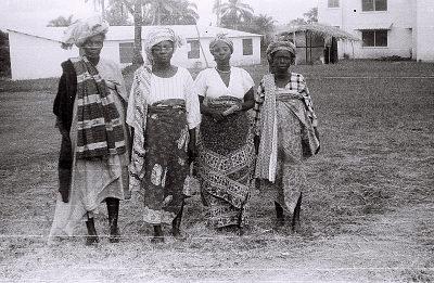 Field Work in Ibadan, Western Region (Nigeria): Four Women (probably Yoruba Informants) Wearing Elaborate Headdresses