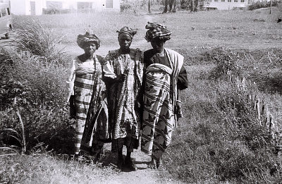 Field Work in Ibadan, Western Region (Nigeria): Two Women and a Man (probably Yoruba Informants) Wearing Traditional Yoruba Clothes and Headdresses
