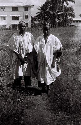 Field Work in Ibadan, Western Region (Nigeria): Two Men (probably Yoruba Informants) Wearing Traditional Yoruba Clothes and Hats