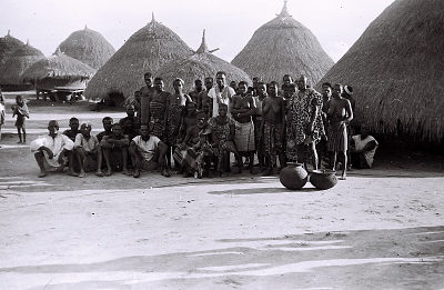 Field Work on the Benue Plateau, Northern Region (Nigeria): Elderly Man, probably a Chief, Surrounded by his Extended Family