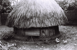 Field Work in Benin (formerly, Dahomey): Small Round House with Thatched Roof and Mural Painting and Decoration