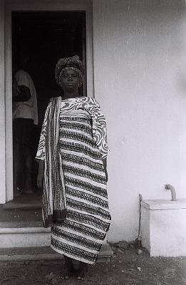Field Work in the Western Region (Nigeria): Standing Woman (probably Yoruba Informant) with Elaborate Headdress