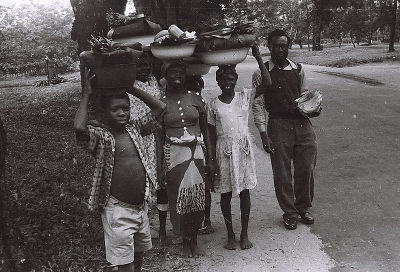Field Work in Aba, Eastern Region (Nigeria): Young Women and Boy Carrying Vegetables in Large Enamelled Tinware