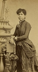 Portrait of African American woman holding a parasol