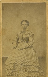Full-length portrait of seated African American woman