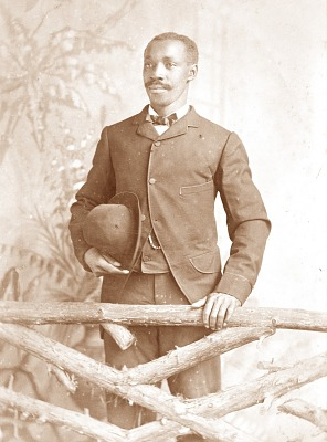 Portrait of African American man holding hat