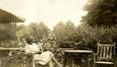 Rosa Jones (Sullivan) Miller sitting in her garden