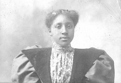 Portrait of African American woman with combs in her hair