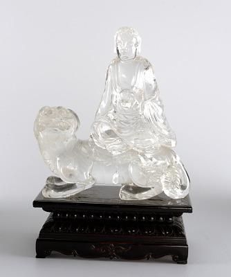 Buddha Seated on Foo Dog