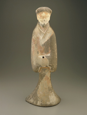 Standing figure of a woman attendant