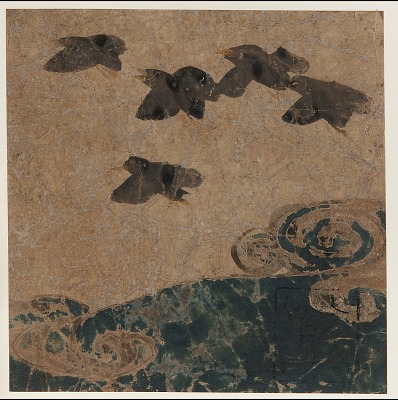 Birds flying over waves