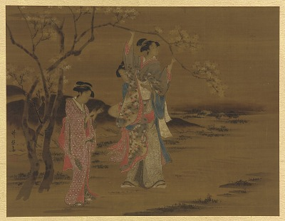 Two girls and a man under a cherry tree