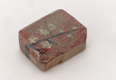 Kenzan-style Red Raku incense container with design of plum