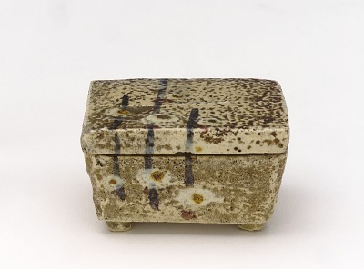 White Raku incense container with design of plum shoots