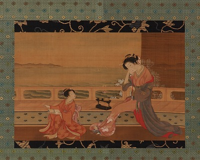 Two girls on a balcony overlooking the sea