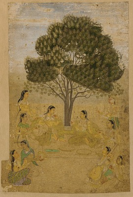 Two ladies seated under a locust tree in flower