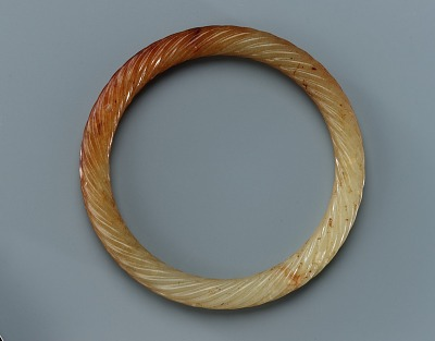 Pendant in the form of a braided ring