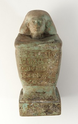 Seated male figure, inscribed