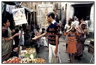 A Vegetable Seller, Clients and Saraswati, Goddess of the Arts, Calcutta, 1985