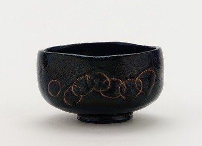 Tea bowl with designs of pine boughs and interlocking circles, unknown Raku ware workshop