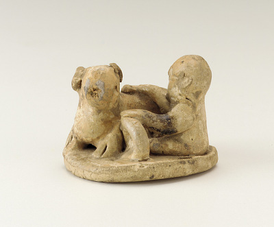 Figure of a child with a dog