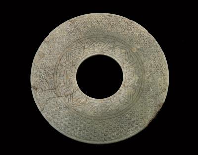 Disk (<em>bi</em>) with knobs, masks and birds