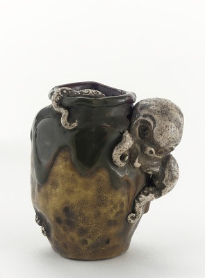 Netsuke in form of miniature jar with emerging octopus
