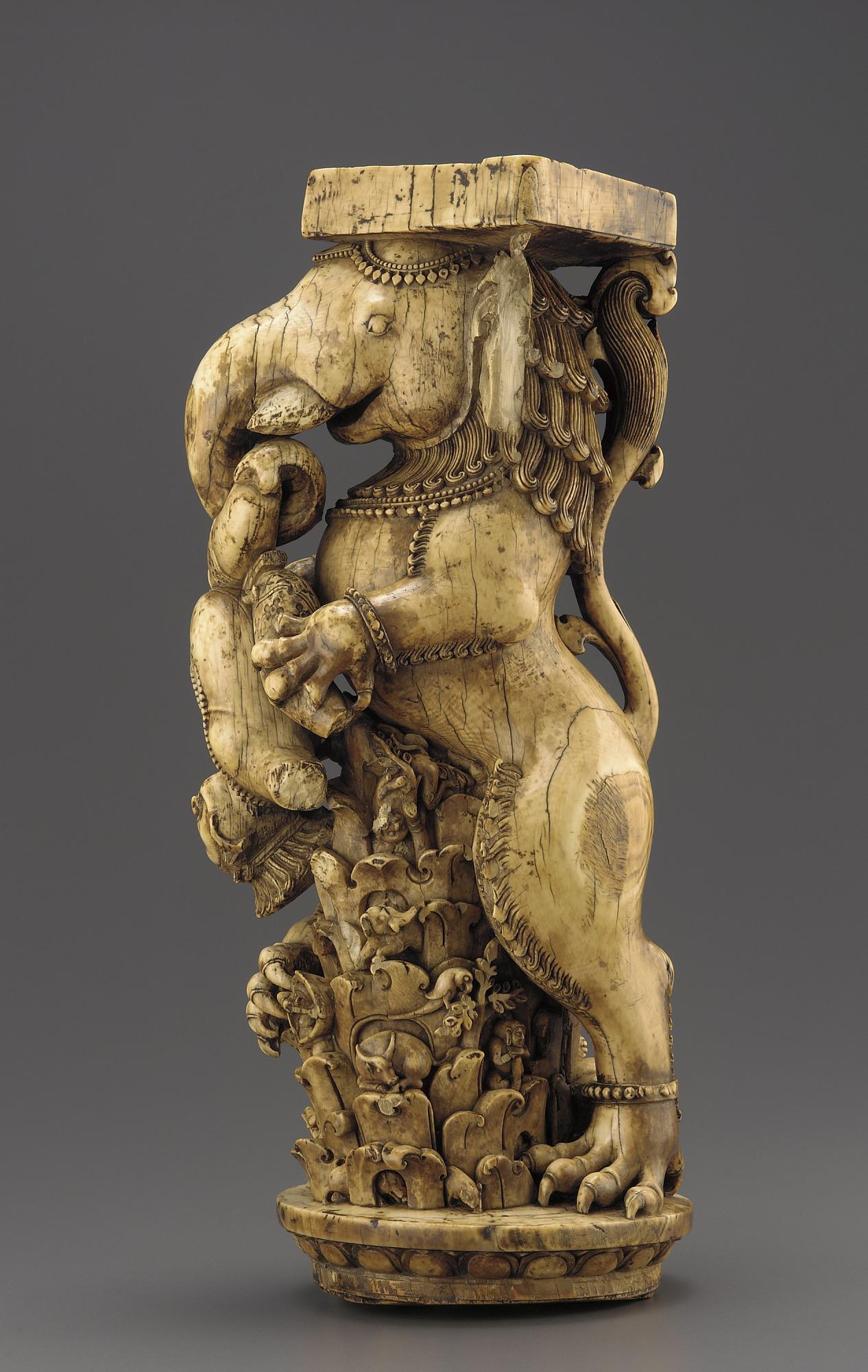proper left: Ivory Throne Leg