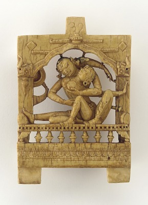 Furniture plaque: lovers embracing on a canopied bed