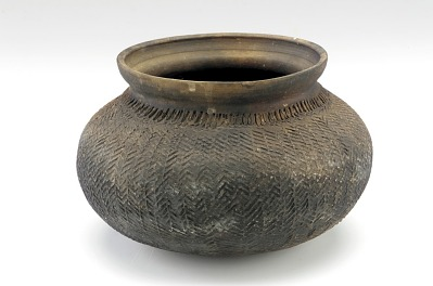 Pot with overall paddle-impressed texture
