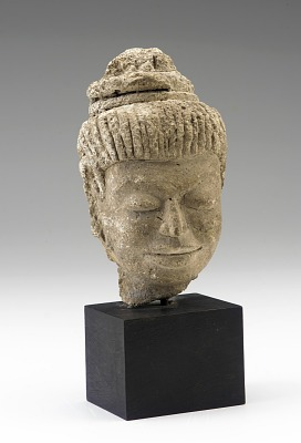 Head of a bodhisattva or attendant figure, possibly a female musician