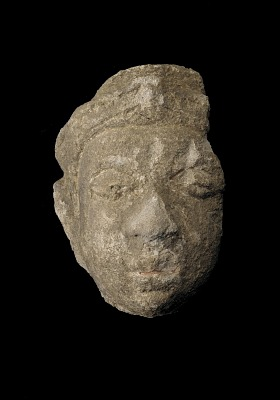 Head of a crowned male figure