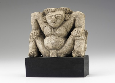 Figure of a squatting yaksha