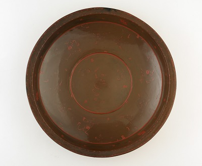 Bowl with decorations overlaid in red and dull brown lacquer