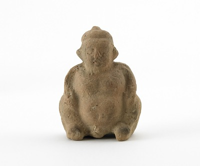 Spirit house figure of a seated boy